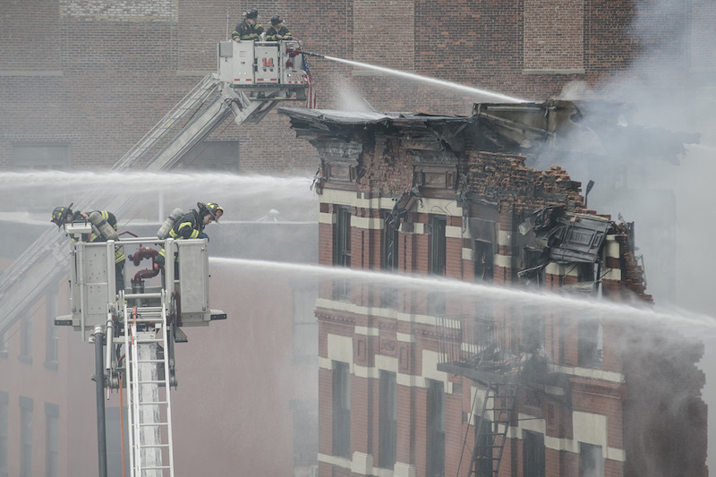 Firefighters spray water on a collapsed building in New York's East Village. The Associated Press