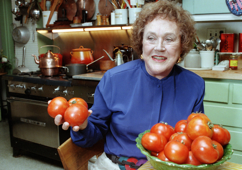 Chef and author Julia Child holds tomatoes in the kitchen at her home in Cambridge, Mass on Aug. 13, 1992. More than a decade after her death, the foundation she created finally is launching a culinary award named in her honor. The Julia Child Award, which will be named annually, will be presented to someone who has improved how Americans think about food and cooking. The first winner will be announced in August 2015 and the award will be presented in October.