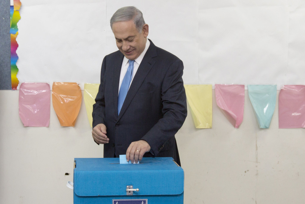 Israeli Prime Minister Benjamin Netanyahu casts his vote during Israel's parliamentary elections in Jerusalem, Tuesday. The Associated Press