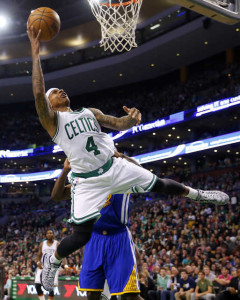Boston Celtics guard Isaiah Thomas lets go an off-balance shot during the second half of the Golden State Warriors' 106-101 win over in Boston on Sunday.