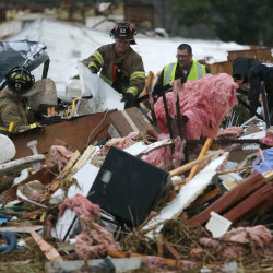 First responders work to free a man from a pile of rubble after a round of severe weather hit a trailer park in Sand Springs, Okla. on Wednesday.