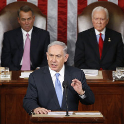 "Israeli Prime Minister Benjamin Netanyahu speaks before a joint meeting of Congress on Capitol Hill Tuesday. The world must unite to ""stop Iran's march of conquest, subjugation and terror,"" he said. House Speaker John Boehner of Ohio, left, and Sen. Orrin Hatch, R-Utah, listen. The Associated Press"