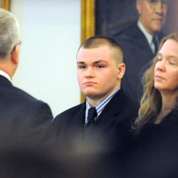 Kyle Dube, center, with his attorneys Stephen Smith, left, and Wendy Hatch appears in court on Feb. 23, the first day of his trial at the Penobscot Judicial Center in Bangor. The Associated Press