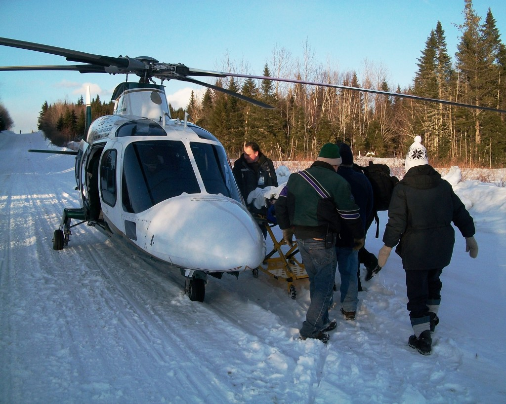 Rescue workers load Laurie Clarke into a LifeFlight helicopter.