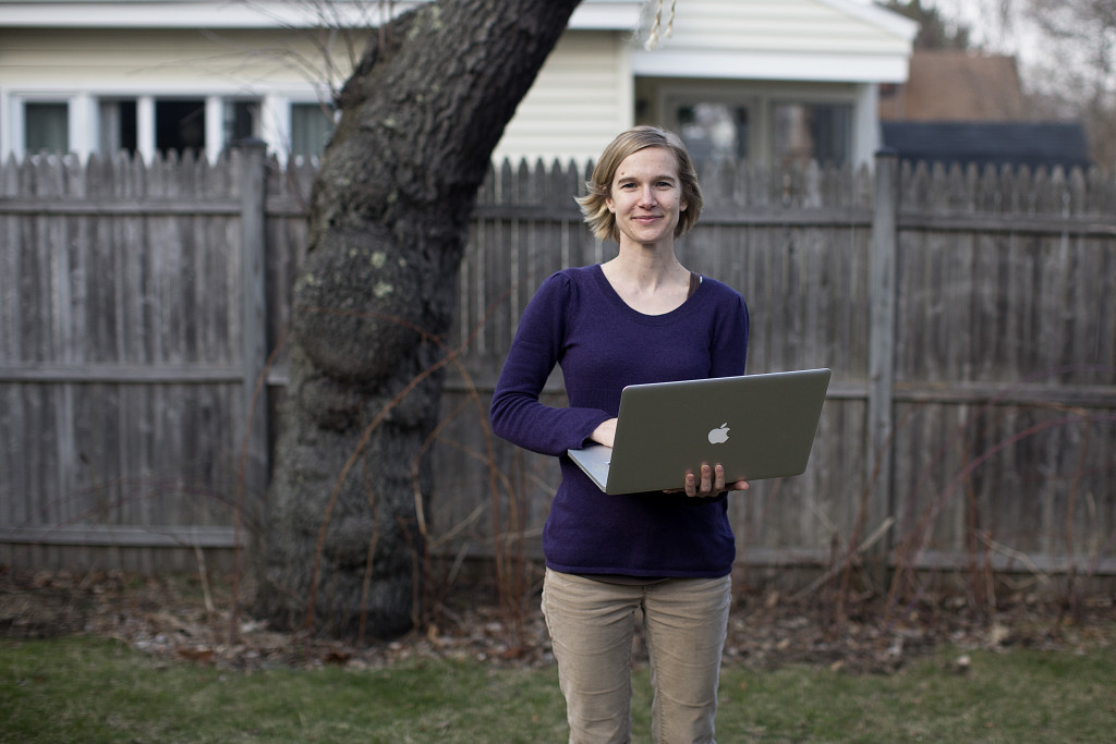 Misty McLaughlin the backyard at her house in South Portland. McLaughlin is a nonprofit consultant and user experience architect who has the ability to work remotely.