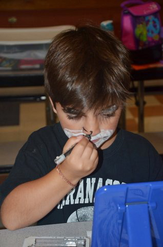 Contributed photo   Rocco Scott, of Readfield, working on his character makeup during last summer's Theatre Arts Day Camp.