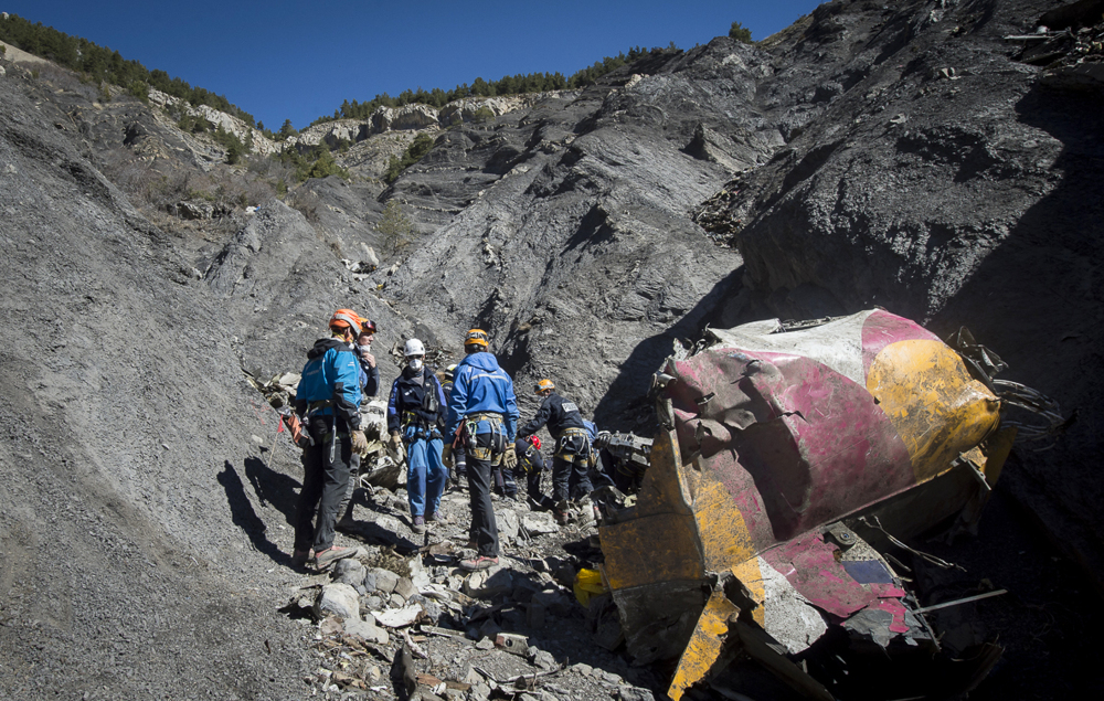 In this photo taken on Tuesday and provided by the French Interior Ministry, French emergency rescue services work among debris of the Germanwings passenger jet at the crash site near Seyne-les-Alpes, France.