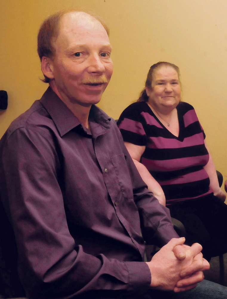 After Michael Fernald received free hearing aids on Thursday, he and his wife, Diane, of Clinton, were happy. Fernald lost his hearing after he was injured in a car accident two years ago.