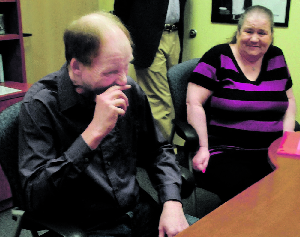 Michael Fernald, of Clinton, and his wife, Diane, cry after Michael received hearing aids that allowed him to hear his wife's voice for the first time since he was injured in a car accident two years ago.