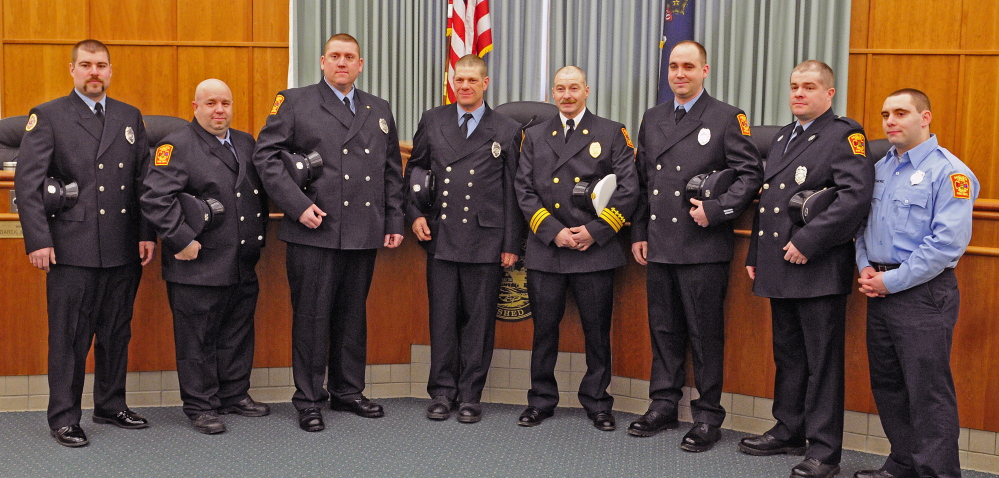 Members of Augusta Fire Department's C shift were presented with a unit citation for their actions in response to a major fire at 36 Northern Ave. at an Augusta City Council meeting on Thursday in Augusta City Center. Shift members are, from left, Jason McKinnon, James Baldwin, Mic Poirier, Bill Lord, Battalion Chief Steve Leach, Lt. Brian Chamberlin, Dustin Freeman and Nick Whitmore. Poirier also received a Medal of Valor for rescuing a resident.