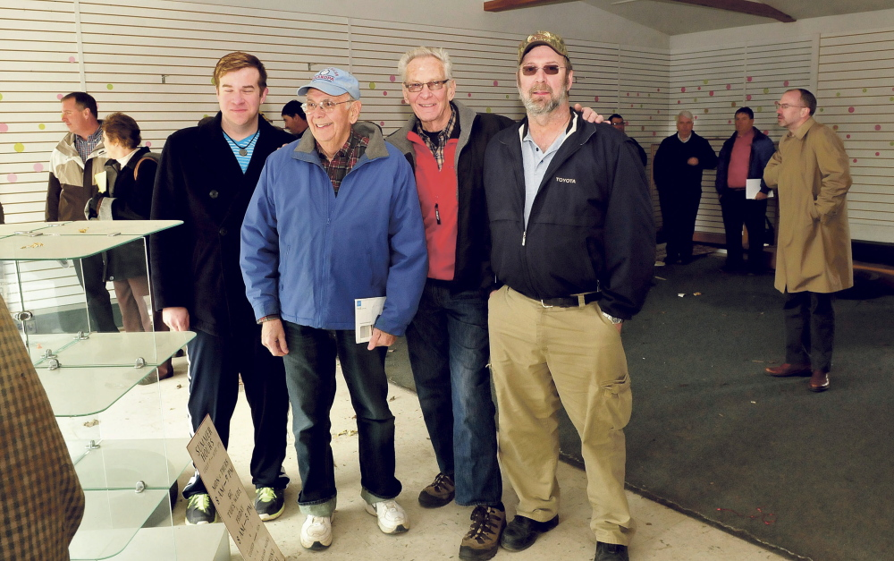 Several generations of Weeks family owned and operated the former A.L. Weeks & Son business in Waterville that was auctioned off on Thursday. From left are Christopher, Harland, Maynard and Chris Weeks. At right is auctioneer Mike Carey.