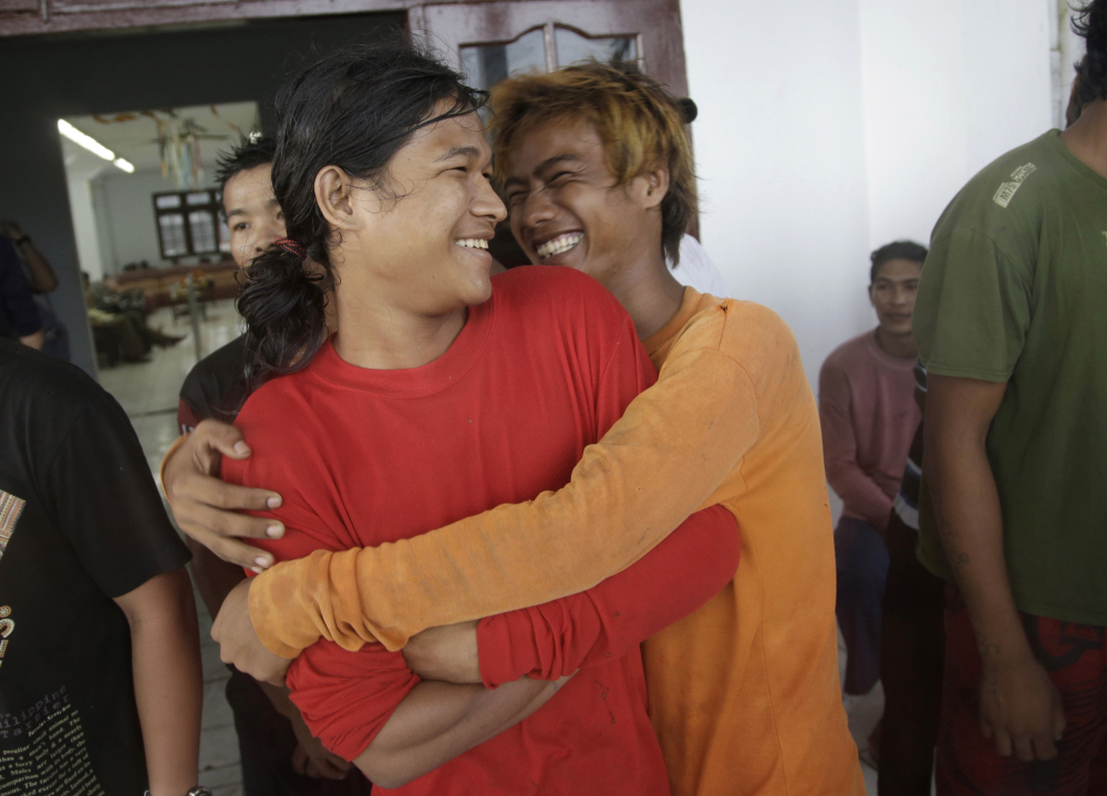 Burmese fishermen hug each other as they wait for their departure to leave the compound of Pusaka Benjina Resources fishing company in Benjina, Aru Islands, Indonesia on Friday. Hundreds of foreign fishermen rushed at the chance to be rescued from the isolated island where an Associated Press report revealed slavery runs rampant in the industry. Indonesian officials investigating abuses offered to take them out of concern for the men's safety.