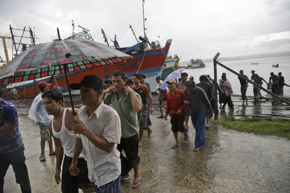 Burmese fishermen arrive at the compound of Pusaka Benjina Resources to report themselves for departure to leave the fishing company in Benjina, Aru Islands, Indonesia.