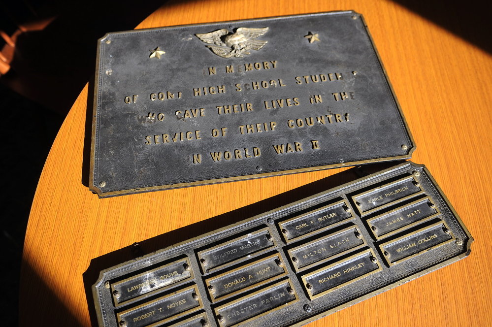 A memorial for Cony High School graduates lost in World War II at the Augusta school last week. Cony senior Kelsey Rohman is leading an effort to have the plaque displayed at the new school.