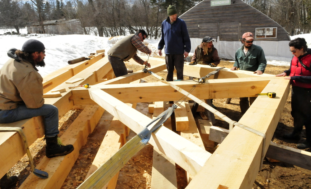 A king post truss is under construction at a farm in Troy that will be installed in the Troy Union Church once funds have been raised. Both local volunteers and members of the Preservation Timber Framing organization worked Tuesday, March 31, 2015. From left are Scott Pfeiffer, Scott Lewis, Marvin Daugherty, Adam Joy, Lee Hoagland and Jessica Milneil.