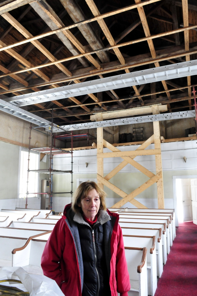 Norma Rossel, project coordinator for the Troy Union Church restoration project, speaks inside the church about the ongoing work.
