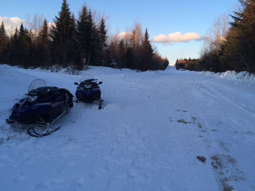 Scene of snowmobile accident on Sunday in Thorndike Township, northeast of Jackman, in which a woman's snowmobile crashed into a machine operated by her husband. The woman was airlifted for emergency treatment, but was reported in good condition on Monday.