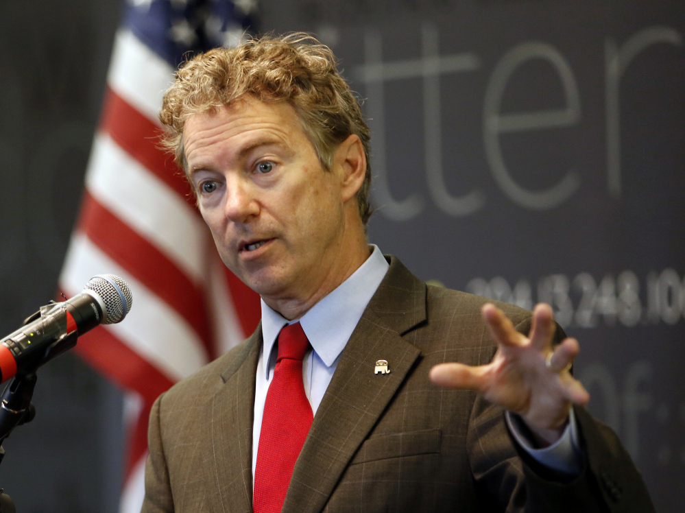 In this March 20, 2015, file photo, Sen., Rand Paul, R-Ky. speaks in Manchester, N.H. Ready to enter the Republican chase for the party's presidential nomination this week, the first-term Kentucky senator has designs on changing how Republicans go about getting elected to the White House and how they govern once there.