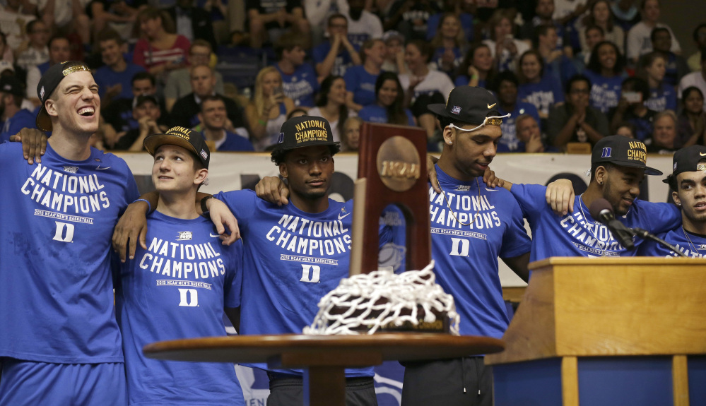Members of the national championship Duke basketball team from left, Marshall Plumlee; Grayson Allen; Justise Winslow; Jahlil Okafor; Matt Jones and Tyrus Jones are welcomed at Cameron Indoor Stadium Tuesday in Durham, N.C. Duke defeated Wisconsin Monday night in the NCAA Final Four tournament championship game.