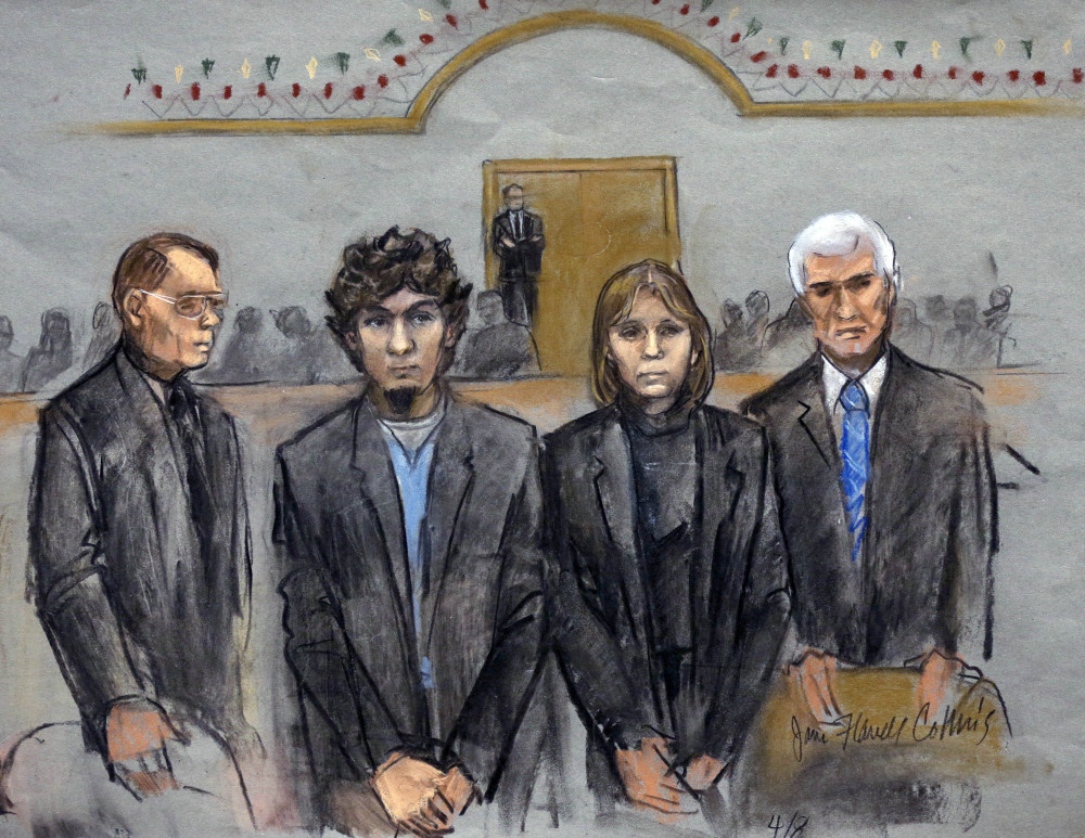 In this courtroom sketch, Dzhokhar Tsarnaev, second from left, stands with defense attorneys William Fick, left, Judy Clarke and David Bruck as the jury announces its verdict Wednesday. Tsarnaev was convicted on all 30 counts against him, 17 of which could carry the death penalty.