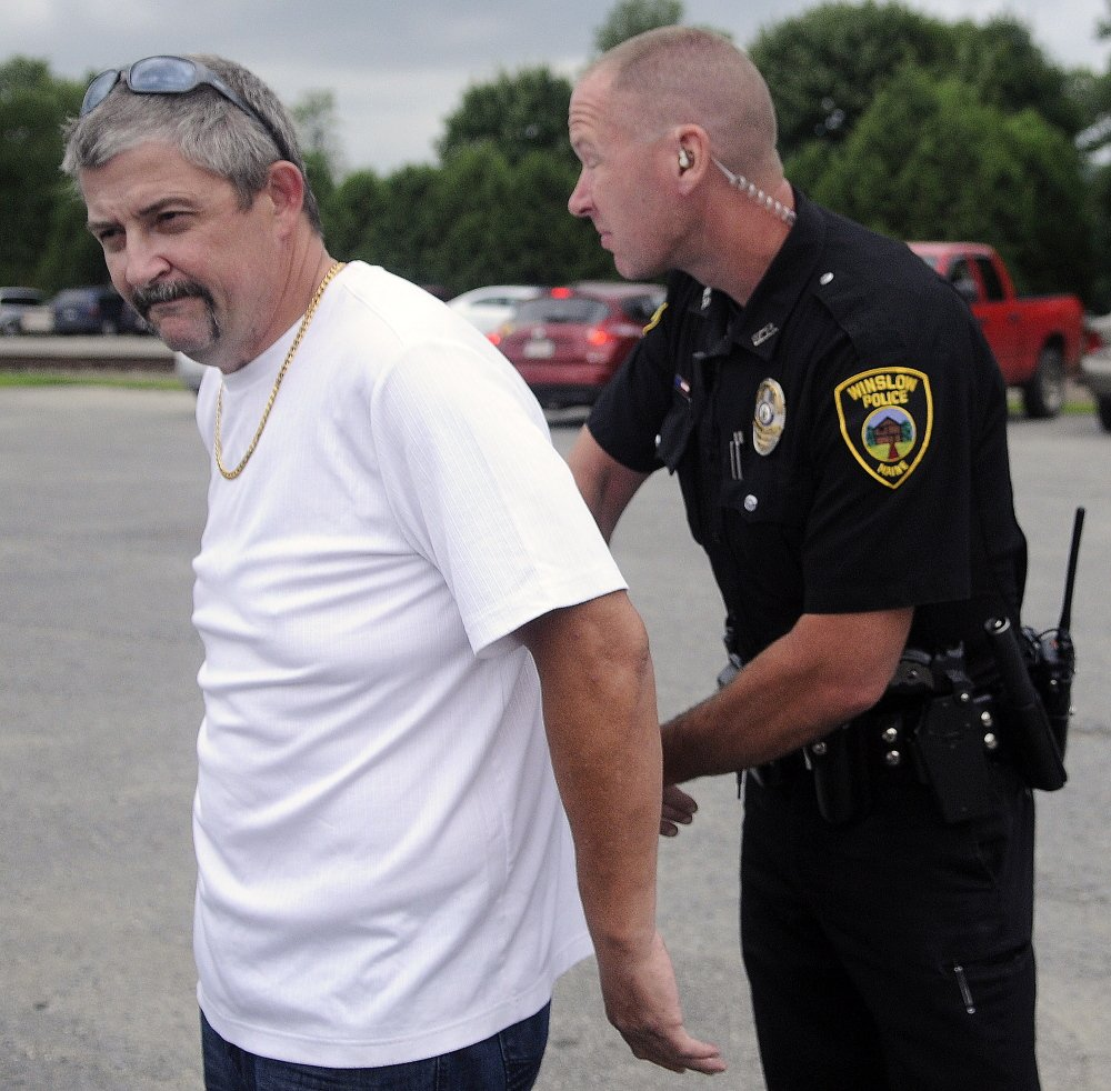 Winslow Police Officer John Veilleux arrests Fred Horne Sr. in July 2014 in the parking lot of Fort Halifax Park in Winslow when he violated the conditions of his bail.