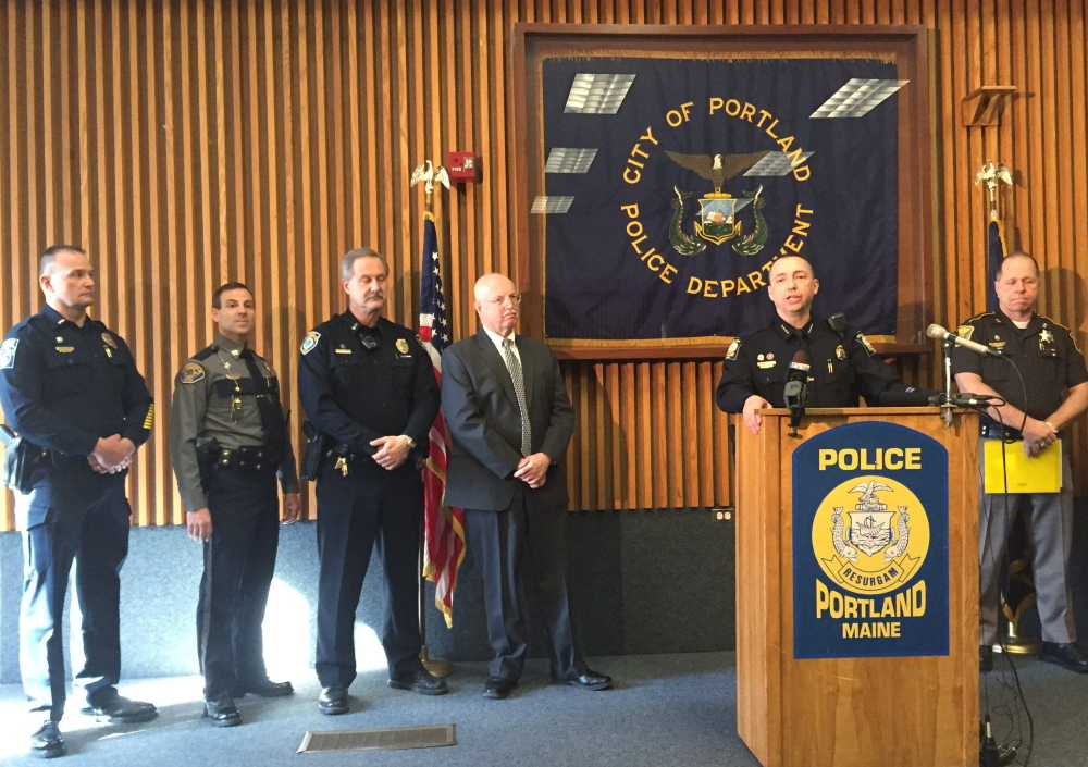 Portland Police Chief Michael Sauschuck, flanked by police officials from throughout Cumberland County, says at a press conference Wednesday that a legislative effort to repeal the requirement for a concealed weapons permit would endanger the public. Photo by Dave Hench / Staff Writer