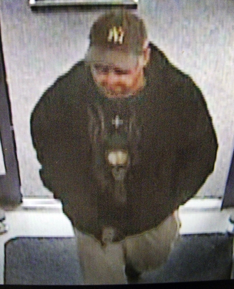 A surveillance photo from the Rite Aid pharmacy in Manchester shows a man later identified as Thomas G. Bourque, 32, of Belgrade.