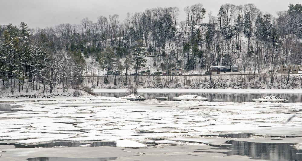 Ice floats downstream past Browns Island on Thursday on the Kennebec River between Randolph and Farmingdale.