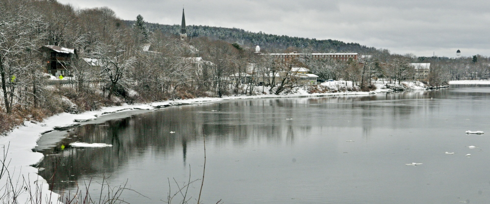 Ice floats downstream on Thursday on the Kennebec River in Hallowell.
