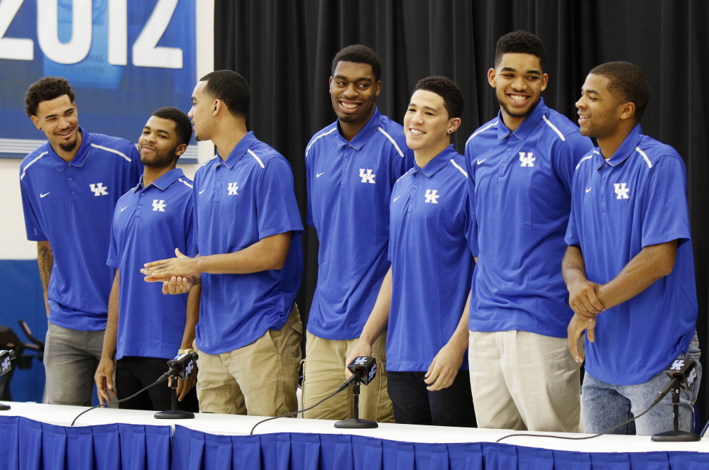 From left, Kentucky basketball players Willie Cauley-Stein, Andrew Harrison, Trey Lyles, Dakari Johnson, Devon Booker, Karl-Anthony Towns and Aaron Harrison stand during a news conference Thursday where they announced their intent to place their names in the NBA draft.