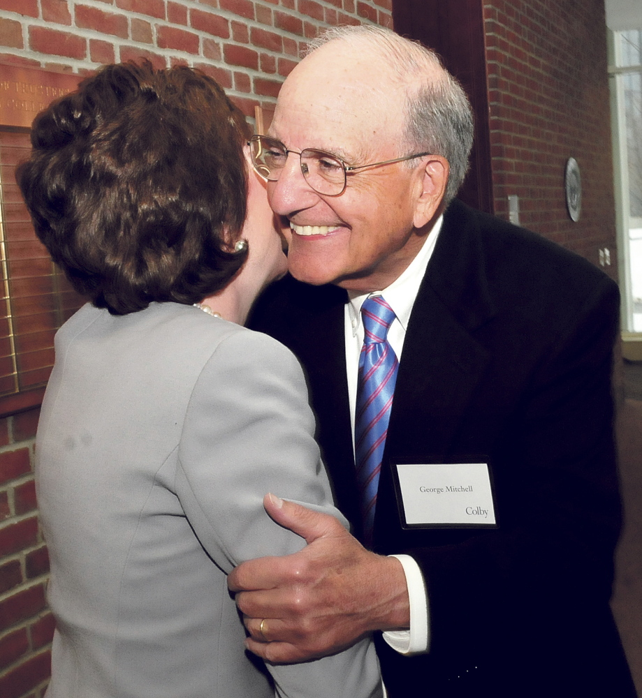Former Sen. George Mitchell hugs U.S. Sen. Susan Collins before she delivers the annual Mitchell lecture at Colby College in Waterville on Thursday.