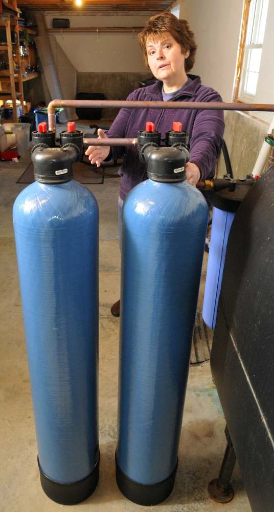 Andrea Tardif-Brann talks about the point of entry water filtration system in her family's Manchester home in this January file photo.