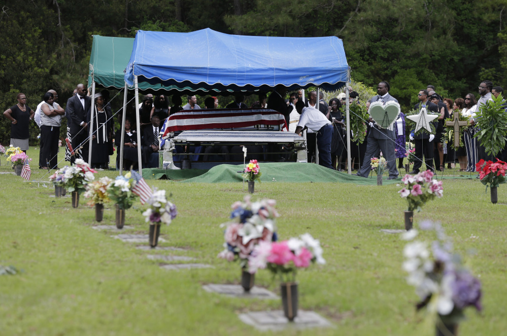 Family and friends attend the burial service for Walter Scott in Charleston, S.C. on Saturday.