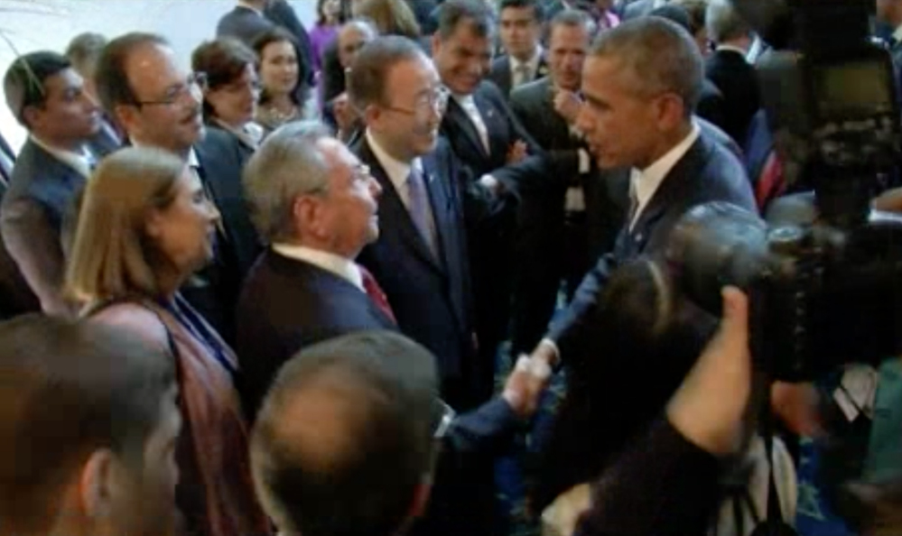 U.S. President Barack Obama and Cuban President Raul Castro exchange handshakes on Friday at the opening of the Summit of the Americas in Panama. The two are expected to meet on Saturday.