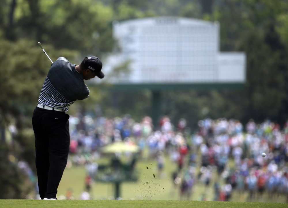 Tiger Woods hits on the second fairway during the third round of the Masters golf tournament on Saturday in Augusta, Ga.