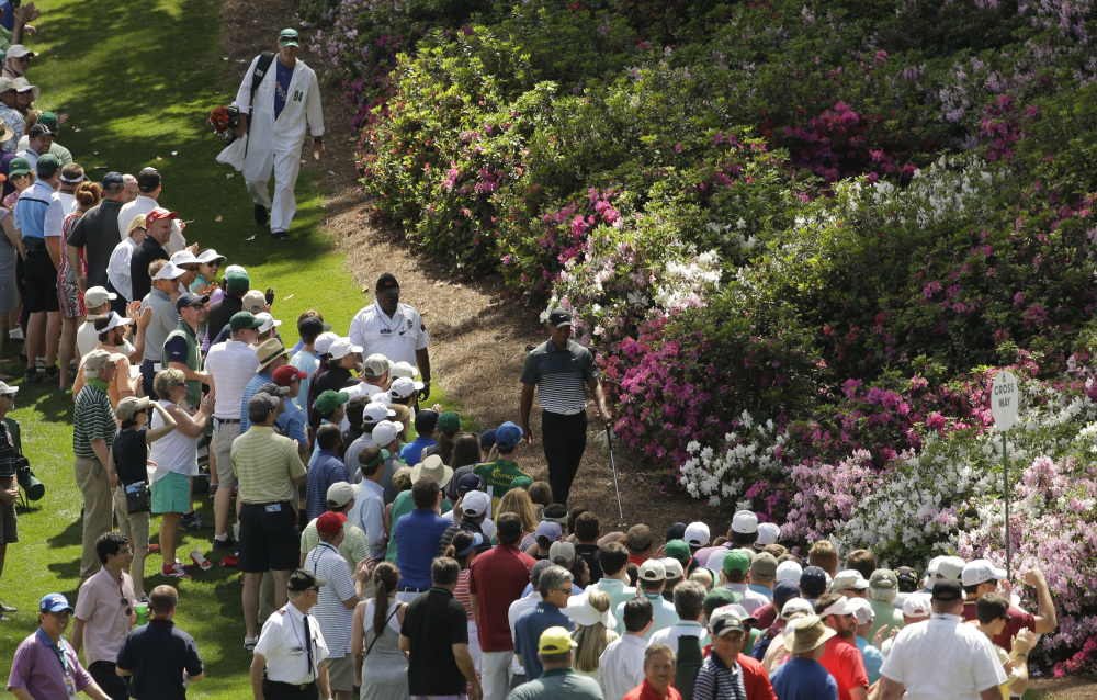 Tiger Woods walks down the sixth fairway during the third round of the Masters golf tournament Saturday in Augusta, Ga.