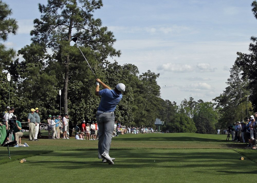 Jordan Spieth tees off on the ninth tee during the third round of the Masters golf tournament Saturday in Augusta, Ga.