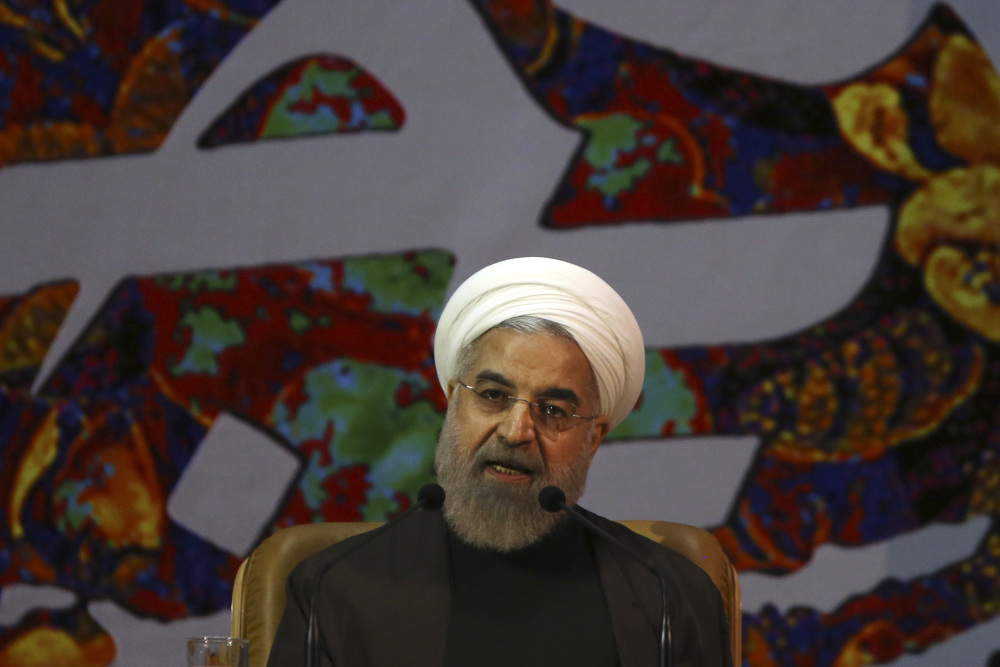 Iranian President Hassan Rouhani speaks at a ceremony to commemorate the late Khadijeh Saghafi, wife of late revolutionary founder Ayatollah Khomeini, in Tehran, Iran, Sunday.