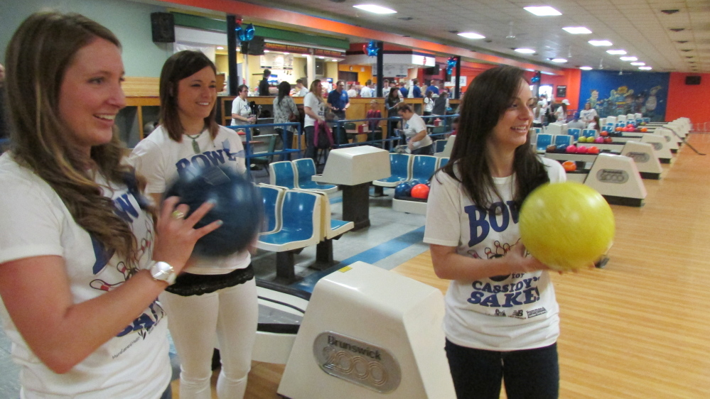 Mackenzie Pinette, Kacey Wilcox and Casey Carson get ready to roll bowling balls during the Bowl for Cassidy's Sake fundraising event Saturday at Spare Time Recreation in Waterville. The event raised more than $36,000 for a Big Brothers Big Sisters program started at Messalonskee High School in Oakland in honor of Cassidy Charette, who was killed in a hayride accident last October.