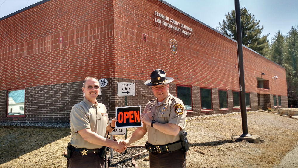 Jail Administrator Doug Blauvelt, left, and Franklin County Sheriff Scott Nichols, right, stand in front of the newly relicensed Franklin County Detention Center. The jail, which was reduced to a 72-hour holding facility, is now allowed to fully operate and to board inmates.