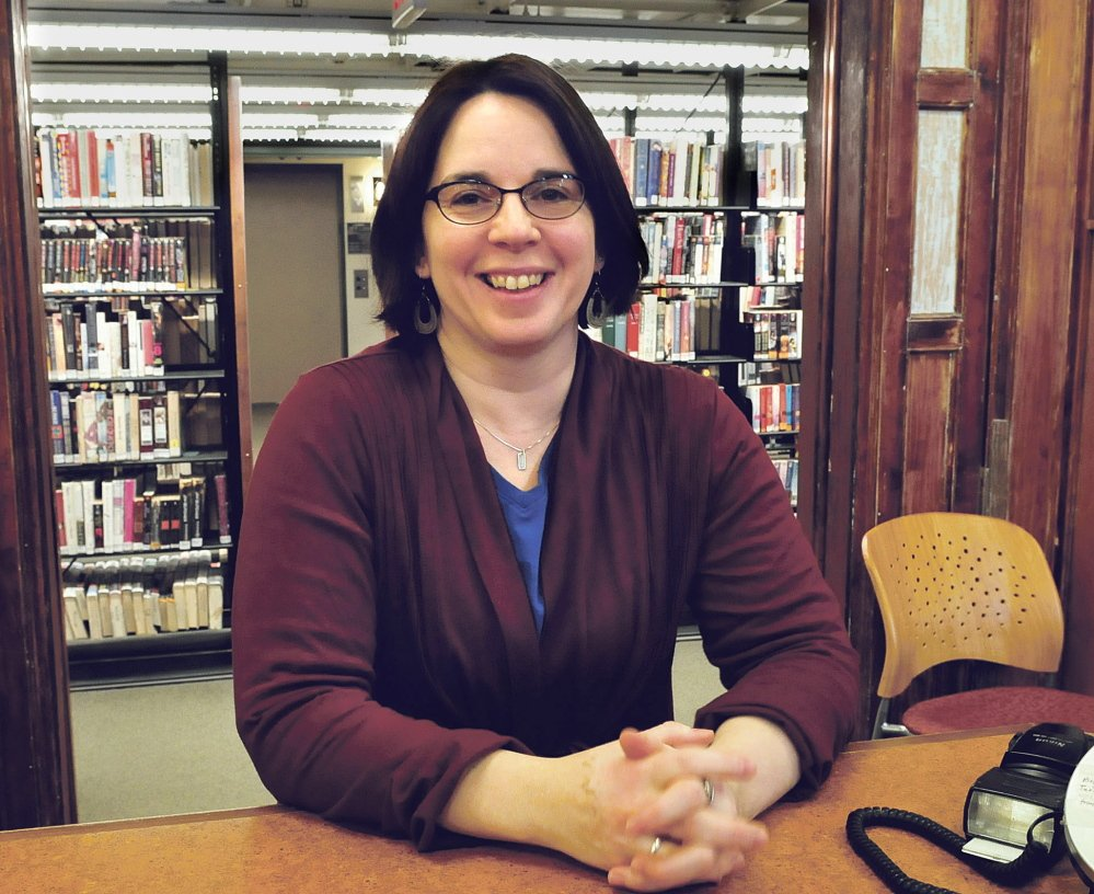 """Tammy Rabideau of the Waterville Public Library has been awarded the Outstanding Professional award by Mid-Maine Chamber of Commerce. Rabideau performs what she calls """"sneaky outreach,"""" connecting visitors to the library with job resources."""