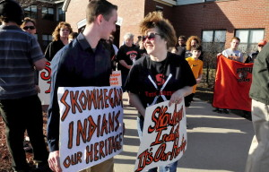 Zachary Queenan and Nicole Carter joined 40 sign-carrying people who held a silent protest against changing the use of the American Indian as a sports mascot in Skowhegan schools before a meeting of SAD 54's education policy program committee and representatives of the Wabanaki federation in Skowhegan on Monday.