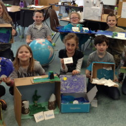 """Wayne Elementary School third-grade students share the handcrafted models they made as part of their """"Incredibly Interesting Geography Exhibit."""" In front, from left, are Eli Reynolds, Lillian Pease, Ariana Tully, Elliot Desjardins and Jacie Dagneau. In back, from left, are Anna Albert, Wyatt Stevenson, Margaret Morrill and Isaac Mason."""