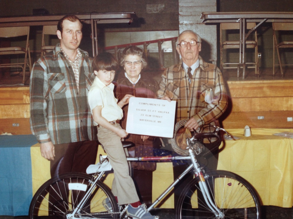 In a photo taken in 1980, Ryan Poulin, 7 years old at the time, poses after winning a new bicycle after winning a credit union contest. He is surrounded by his father Gerald Poulin, at left, and his late grandparents, Alfred and Desange Poulin.