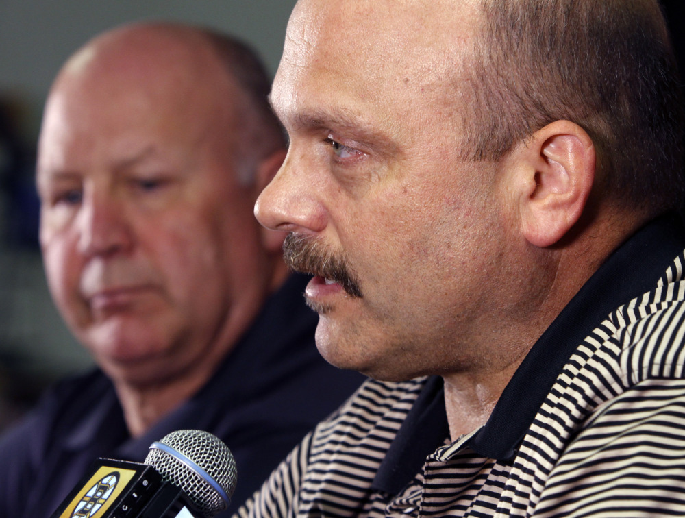 Boston Bruins general manager Peter Chiarelli, right, speaks alongside head coach Claude Julien at a news conference at TD Garden Monday. Chiarelli was fired Wednesda after the Bruins failed to reach the playoffs for the first time in eight years.