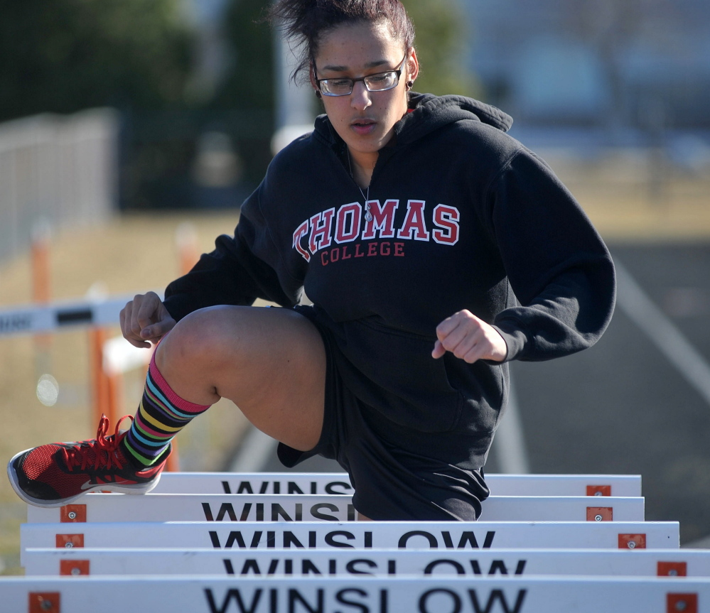 Thomas College sophomore, Sarah Fleming works out during track club practice Wednesday at Winslow High School.