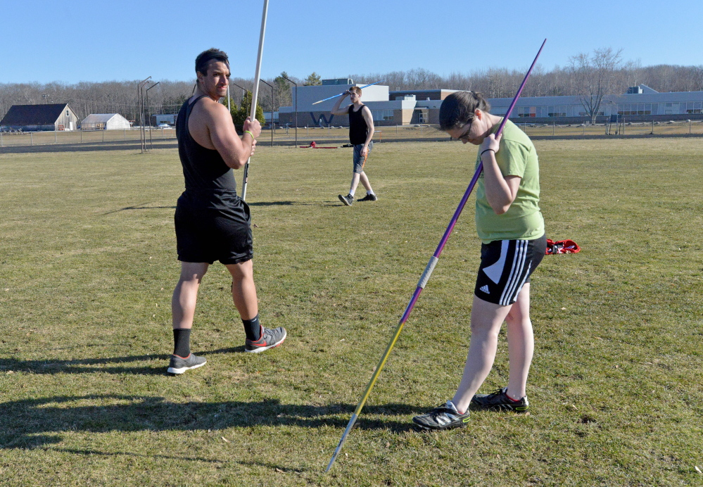 Nolan Callahan, left Michael Chambers, back center, and Katy Donovan, right, work out during the Thomas College track club practice Wednesday at Winslow High School.