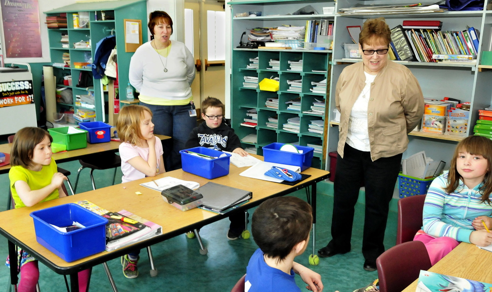 Staff photo by David Leaming Longtime SAD 13 educator Linda Hunnewell, right, visits the second grade classroom where she once taught at Moscow Elementary on Thursday. Next to her is her daughter, Wendy Belanger, who teaches at the school.