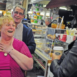 Lois Davis, left, jokes with guests Tim Comeford, background, and Rhonda Wiles-Rosell on Friday during her retirement party at Day's Store in Belgrade Lakes.