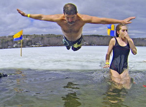 John Lanoue, left, of Bedford, N.H. and his daughter Laura Lanoue plunge into Maranacook Lake on last Saturday in Winthrop.